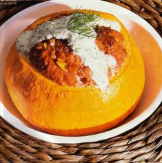 The filled pumpkin recipe is a German dish and popular in fall when pumpkins are ripe. It is filled with ground beef and topped with a dill cream. #germanrecipes