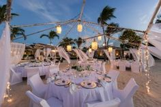 The elegant beach wedding setting here is shown courtesy of Jumby Bay, a Rosewood Resort, the elite island destination off the coast of Antigua,
