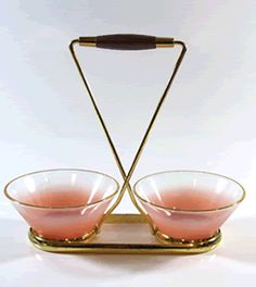 vintage barware accessories - this mid century modern set of 2 cocktail bowls dates from the 60's and was made by the west Virginia glass company the pink frosted bowls sit in a metal tray with wooden handles