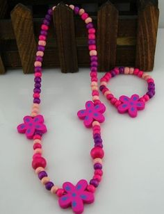 Set 19 Necklace and bracelet set  Made from wood  From China  RM11 per set  PRE ORDER now..