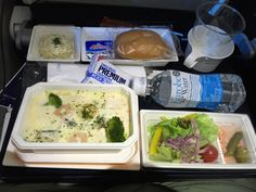 ANA 217, Tokyo-Haneda - Munich (economy) International lunch option: Seafood casserole in cream sauce with steamed rice and vegetables, Mixed salad with pickled herring, Bread, butter, cheese and crackers, Sweet potato salad with corn, Haagen-Dazs vanilla ice cream