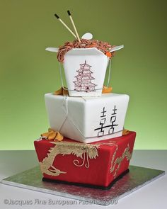Althought this is a cake, this would make a cute centerpiece. Google Image Result for http://4.bp.blogspot.com/_SO0B3Q_Mmus/S_GIN0H1KzI/AAAAAAAAEOg/vx4XZLP_TbY/s1600/chinese%2Bwedding%2Bcake.jpg