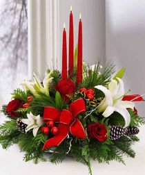 A Christmas Holiday Centerpiece -- Bring #holiday cheer with this centerpiece featuring an assortment of holiday #flowers, candles, ornaments, and lush #Christmas greens.