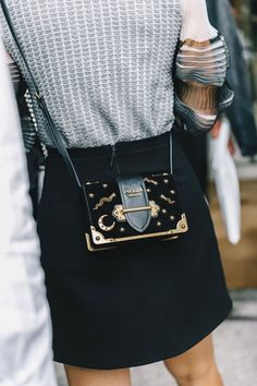 Street Style Milan Fashion Week, black and gold mini bag. Great stylish accessories to complete any outfit. Fashion Week, Look Fashion, High Fashion, Womens Fashion, Fashion Trends, Winter Fashion, Fashion Mode, Milan Fashion, Fashion 2017