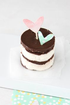 tiny cake with heart toppers