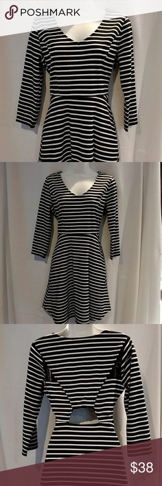 NWT Long Sleeve Dress by American Rag Size M Very nice body con dress with some stretch black and white striped. Flirty back has a small opening and mesh see through mesh material on the back shoulders. American Rag Dresses