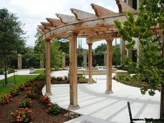 Custom Heavy beam radius pergola in Sugar Land, Texas.