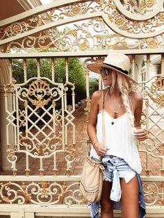 bleach blonde long braid, light sun hat, white flowy tank top, light wash denim shorts, boho side bag, gypsy layered necklaces