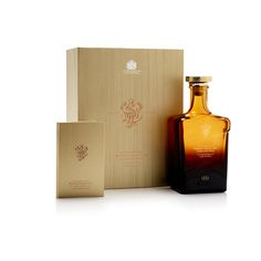 The box was crafted using complex rigid board construction, and is wrapped in bespoke paper stock, debossed with a fine wood grain effect. On the front of the case, the John Walker & Sons monogram is displayed in deep copper foil. Providing a striking contrast is the silver foil Royal Warrant emblem. The whisky bottle is held snugly in a fitted recess in the main body of the case, and can be easily slipped out with an attached copper ribbon. Opposite rests a hardback information booklet. Luxury Packaging, Custom Packaging, Johnnie Walker Whisky, Luxury Cosmetics, Packaging Manufacturers, Packaging Solutions, Concept Board, Wood Grain, Booklet