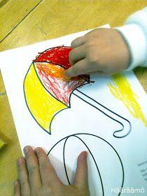 Oranssin sekoittaminen öljypastelliliiduilla Plastic Cutting Board