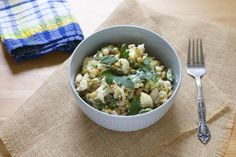 roasted cauliflower and white bean salad with lemony tahini sauce, capers, and toasted pine nuts // themuffinmyth.com