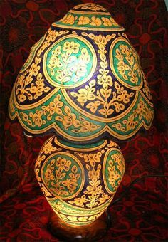 A table lamp made out of camel skin and beautifully painted in floral patterns. Multan is well known for such handicrafts. #camelskin #homedecor #Pakistan