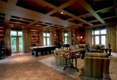 A great room calls for a great, custom floor. Here the call is answered beautifully by a pillowed-edge hickory design. The intricacy of the design demands expert craftsmanship, a Schenck & Company trademark.