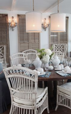 Inside a Rehoboth Beach House by Jerry Harpole. We love the white hanging lights and wooden chairs/panels. Having afternoon tea in this house would be a real treat!