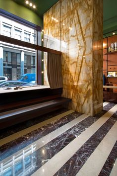 Emiliano Salci and Britt Moran of Dimore Studio wanted to create for Boglioli an atmosphere that harked back to an era of opulence and grandeur and our task was to provide the stone that would bring that brief to life. Whilst Botticino was the material of choice for the floors and staircase, we also created a contrasting stripe effect in Rosso Levanto, and managed the not inconsiderable challenge of providing book-matched slabs almost 3 metres high of Giallo Siena for the entrance wall.