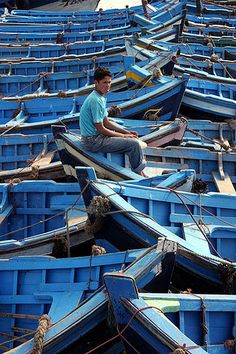 Fisherman in blue, As Suwayrah, Essaouira, Morocco // by Graham Currey