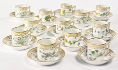 A SET OF TWELVE ROYAL COPENHAGEN 'FLORA DANICA' COFFEE CANS AND SAUCERS MODERN standard printed and painted factory marks and shape number 20 3512.