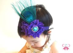 Teal and Purple Peacock Headband, newborn headband, baby girls headband, Birthday headband, Flower girl headband, Feather fascinator. $16.99, via Etsy.