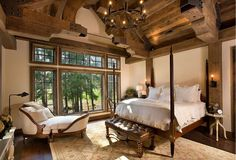 Gorgeous architecture and lavish views enhance this lodge bedroom  - The Beauty and Comfort of Lodge Style Interiors