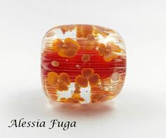 Handmade focal lampwork glass bead in red and coral with flowers di alessiafuga su Etsy