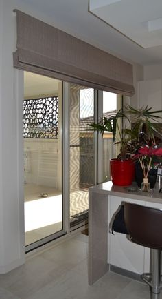 Solar roller shade on a sliding door sliders and patio door ideas roman blinds can be made up to wide with a headrail system how to make curtains for french doors planetlyrics Choice Image