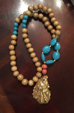 A personal favorite from my Etsy shop https://www.etsy.com/listing/460547202/gold-oyster-shell-necklace-38-turqoise
