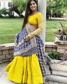 Yellow Annus Creation Lehenga with blue bandhani dupatta. Choli Blouse Design, Choli Designs, Lehenga Designs, Saree Blouse Designs, Chaniya Choli Designer, Designer Bridal Lehenga, Indian Bridal Lehenga, Indian Gowns Dresses, Indian Fashion Dresses