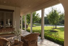Front patio with porch swing of an American Country House in Dallas, TX