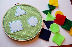 Busy bag toddler shapes activity using embroidery hoop and cut-out felt shapes.
