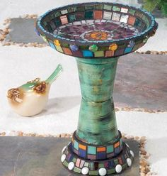 Look closely at this mosaic birdbath: thats two terracotta pots and two terracotta pot saucers, one of which is really large.