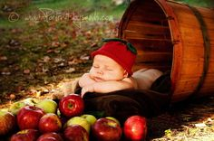 newborn and apples