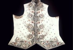 Gentleman's waistcoat woth border design at bottom and front of large flowers.