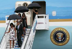 Michelle Obama Arrived in Cuba Wearing Carolina Herrera. While Malia and Sasha both opted for the trusty dress-and-sneakers combo.