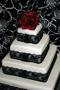 black lace wedding cake with red rose topper ......add a bit of quilting and this is our cake :-)