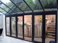 Malpas Cheshire : Design and Build : Ultra frame Roof system Aluminium External Capping PvcU Internal.Slimfold A10 Aluminium Bi Fold doors, double glazed   Polyester Powder Coated  Ral
