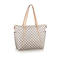 Discover Louis Vuitton Totally MM: The ultimate city tote in Damier Azur canvas with pockets galore. Magazines, tickets, sunglasses are all easily within grasp, while the bag itself is a comfortable fit for any shoulder.