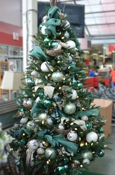 brown and teal christmas trees | Love the teal and white accents to this Christmas tree