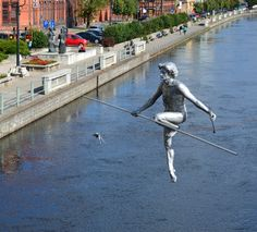 "Balancing sculpture 'Man Crossing the River' (Passes Through The River Monument) by Jerzy ""JOTKA"" Kędziora - Stary Port, Brda River, Bydgoszcz, Poland"
