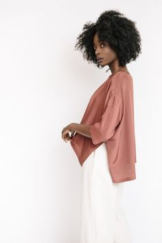 "The silk sweater top in marsala from Revisited Matters features a flowly silhouette with short sleeves and side slits details. Also available in pink and black. Model is 5'9"". - One size fits most - 1"