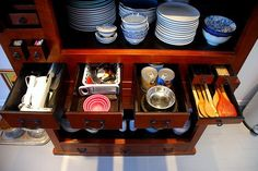Tuck dishes and cooking utensils into an old armoir for sophisticated storage. #kitchen #organize