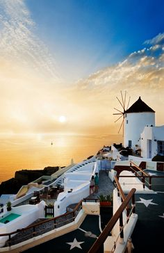 Catch the famous sunset in Santorini, Greece.