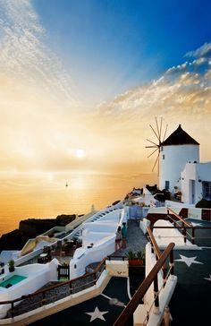 Catch the famous sunset in Santorini, Greece.