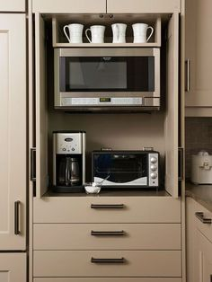 Genius way to hide your not-so-small kitchen appliances with a cabinet TV entertainment unit. Doors are inset and retract into the cabinet while open.  Doors must remain open while in use.