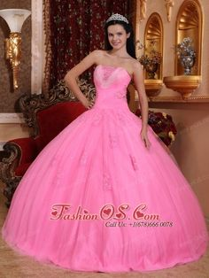 Wonderful Rose Pink Quinceanera Dress Strapless Tulle Beading Ball Gown  http://www.fashionos.com    Take a spin on the dance floor in the flowing ball gown skirt. Strapless neckline corset bodice is gorgeous with beading, embroidery, and lace up back.The upper bodice accented by the dazling beadwork and the folwer applique on the skirt. The dress in any color you like, its will show your lovely on the crown when you wear the dress.