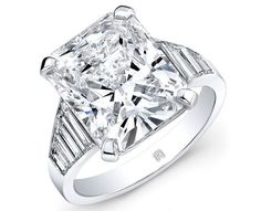 Idée et inspiration Bague Diamant :   Image   Description   Thumbs up for the slick and smooth piece of jewelry! This platinum engagement ring by Rahaminov Diamonds features an incredible 7.77 ct. radiant-cut diamond center with trapezoid-cut diamonds running down the sides. Minimalist and...