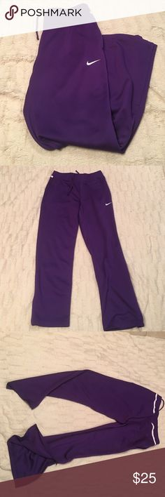"EUC purple Nike pants. Purple Nike pants. White stripe across back end. Side Zip up ankle. Pockets. Size M. 41"" long. Worn maybe 1 or 2x. Only wear is a slight pulling on very bottom as pictured. Open to offers. *these are women's Nike Pants Track Pants & Joggers"