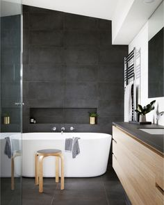 Practical and stylish, this modern bathroom embraces a moody palette with large-format black tiles – making a bold statement! Large Tile Bathroom, Black Tile Bathrooms, Bathtub Tile, Modern Master Bathroom, Modern Farmhouse Bathroom, Large Bathrooms, Master Shower, Bad Inspiration, Bathroom Inspiration