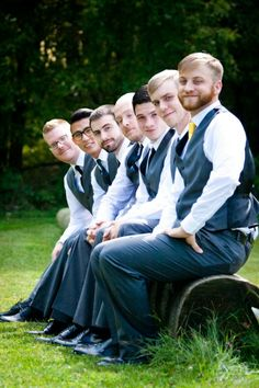 Get everyone in the shot while letting them stay seated! They'll be thankful for the break :) Groomsmen poses, large wedding party, photography angles,