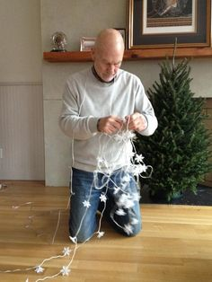 Patrick Stewart untangling Christmas lights.  Make it so.