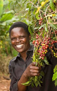 A Fairtrade coffee farmer from Uganda. Image © by Simon Rawles. #imabzzagent